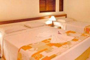 Apartamento Standard com detalhes da cama casal
